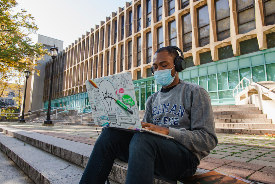Student sitting on campus with Laptop