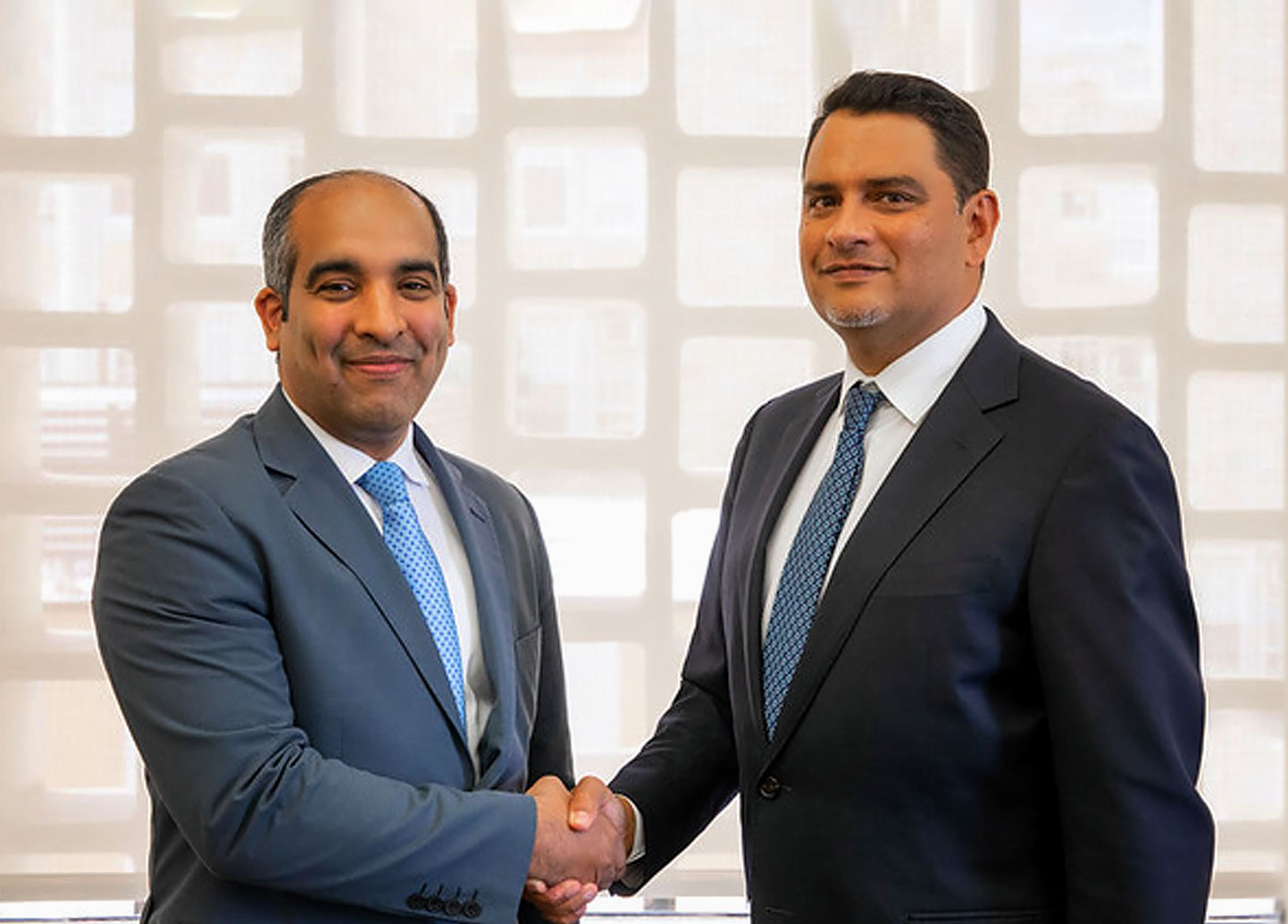 Photo of Lehman College President José Luis Cruz meeting with ITLA President José Armando Tavárez of the Dominican Republic Institute